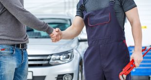 Car owner shaking hands with his mechanic