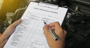 Auto mechanics using a vehicle maintenance checklist