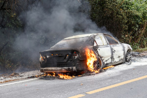 CHIANG MAI THAILAND - JANUARY 1 : Car fire due to a gas explosion. While driving up to the hill. This makes all the damaged on car but driver is safe on January 1 2015 in Chiang Mai Thailand.