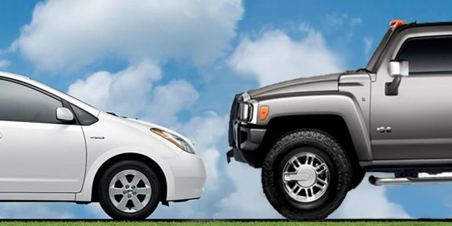 White Toyota Prius facing a Silver Hummer