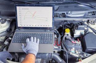 Auto mechanic tuning an ECU using a computer