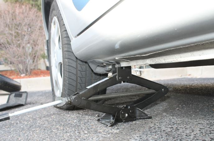 changing tire with car emergency kit