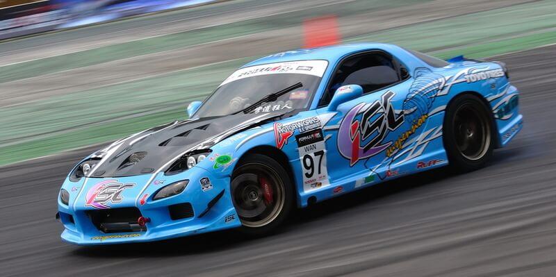 Blue Mazda RX-7 FD drifting