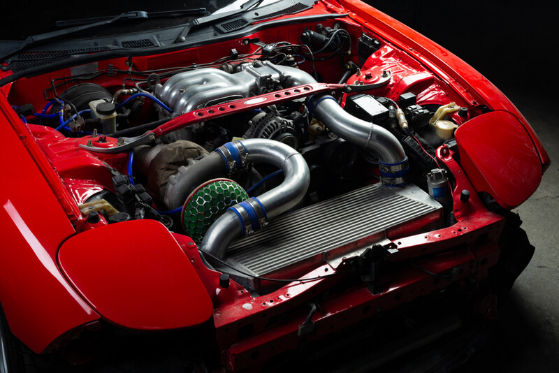 Red Mazda RX-7 FD3S with a 13B-REW engine