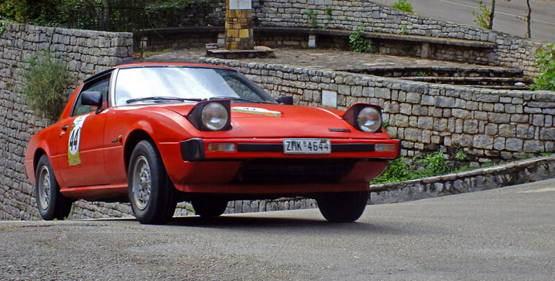 Red Mazda RX-7 FB first generation