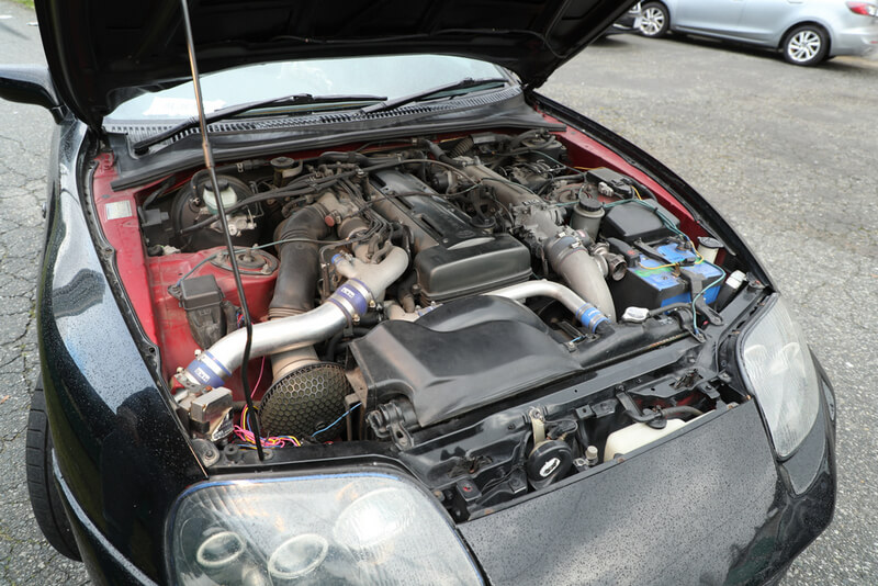 Black Toyota Supra MK4 equipped with a 2JZ-GTE engine