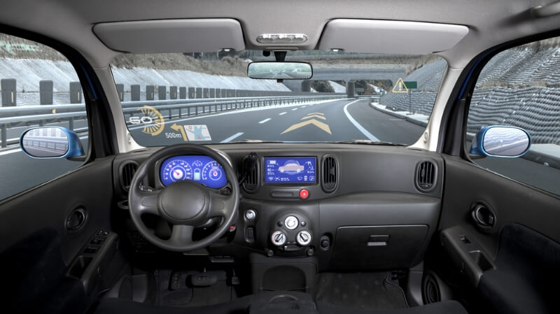 Inside view of a car featuring a heads-up display