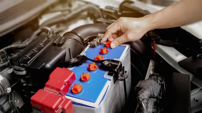 Auto mechanic replacin  a car battery