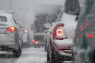 Multiple cars stuck in a traffic jam in the winter