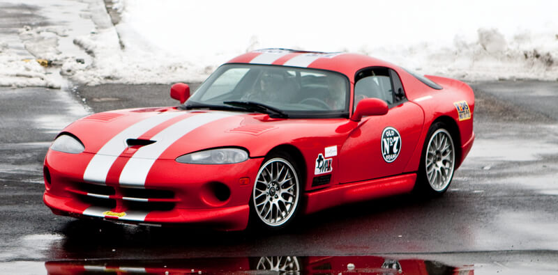 Red Dodge Viper with white racing stripes
