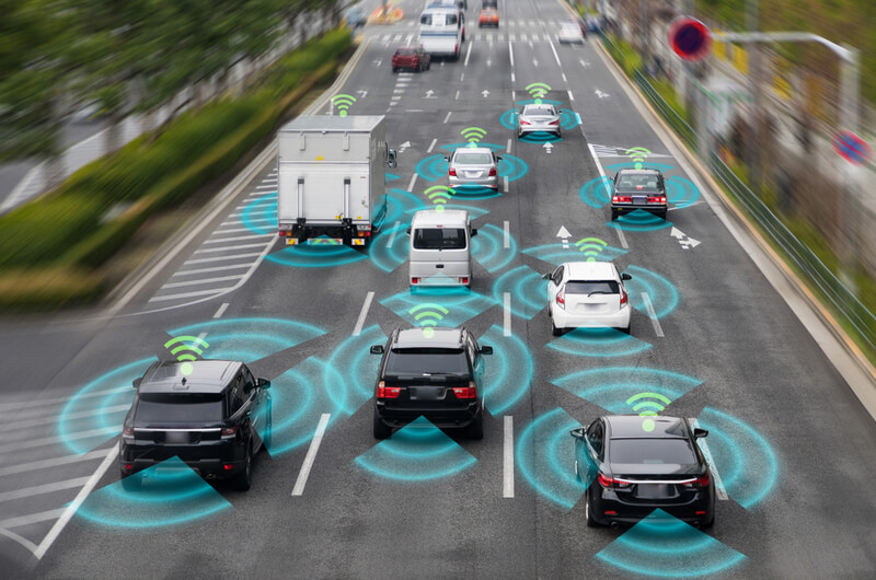 Cars using adaptative cruise control in traffic