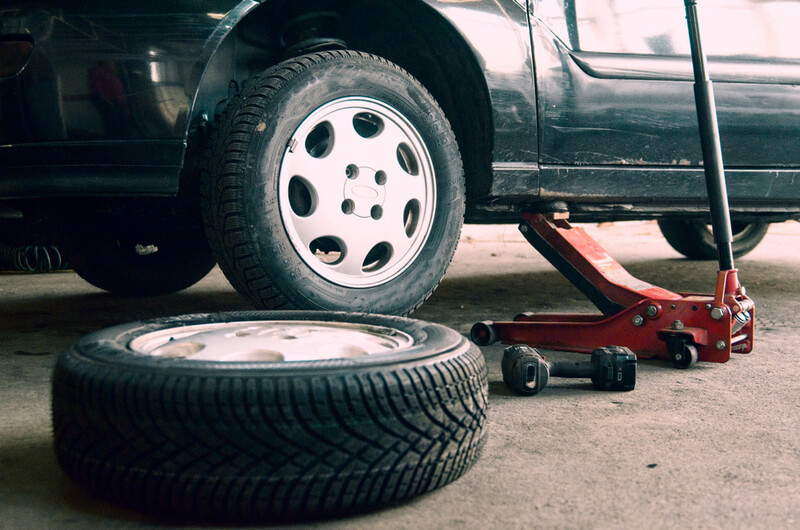 Vehicle jacked to change car tire