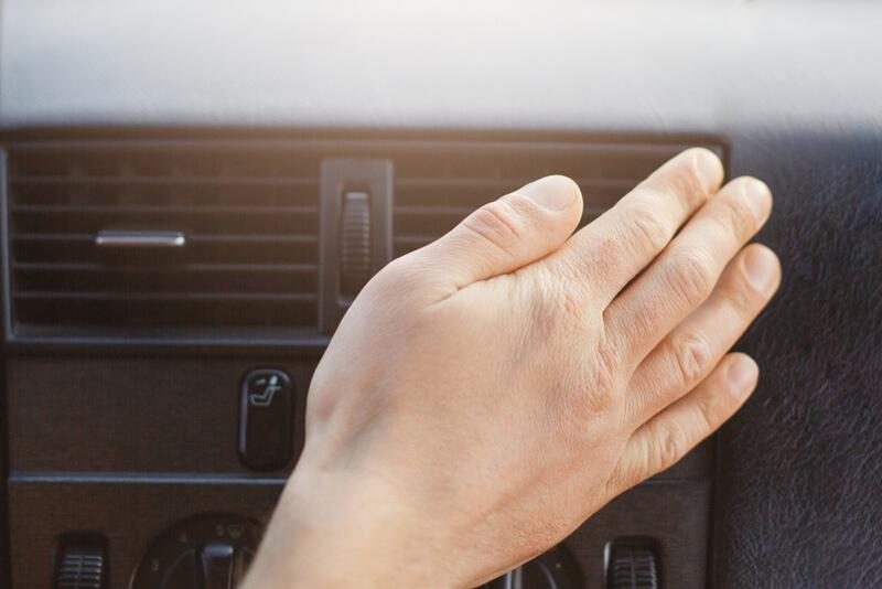 Man adjusting car air vent