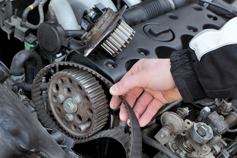 Auto mechanic replacing a bad water pump