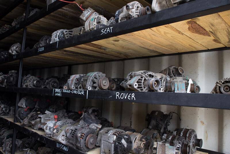 Alternators in a junkyard car parts wharehouse