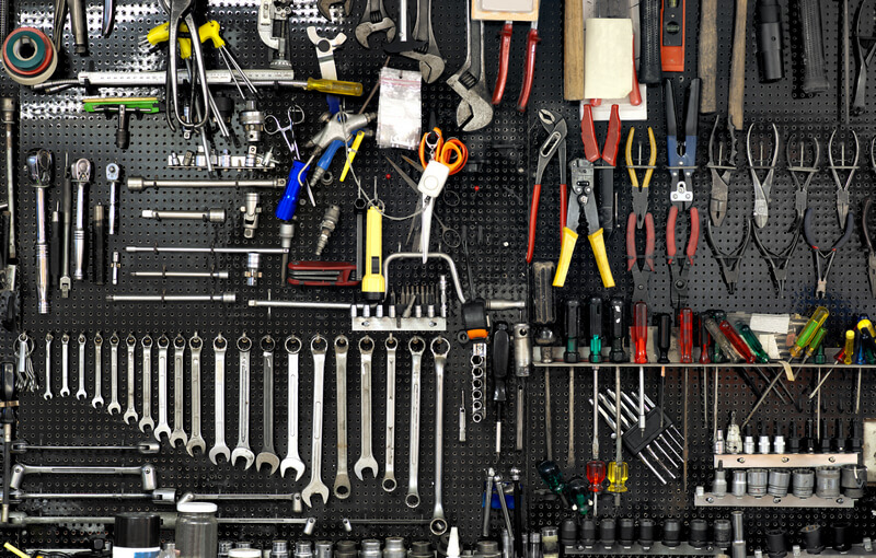 Tools neatly organized using a pin board