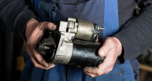 Auto mechanic replacing a starter