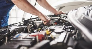 Auto mechanic performing car maintenance