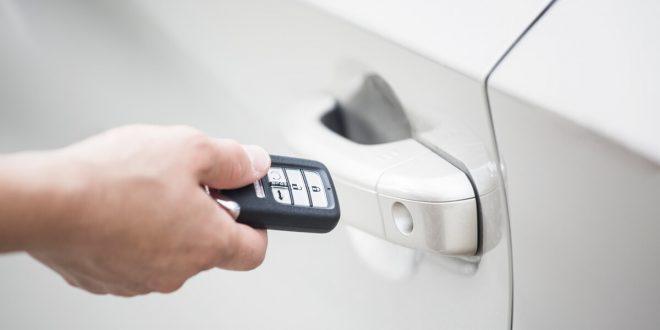 Man unlocking doors with a key fob