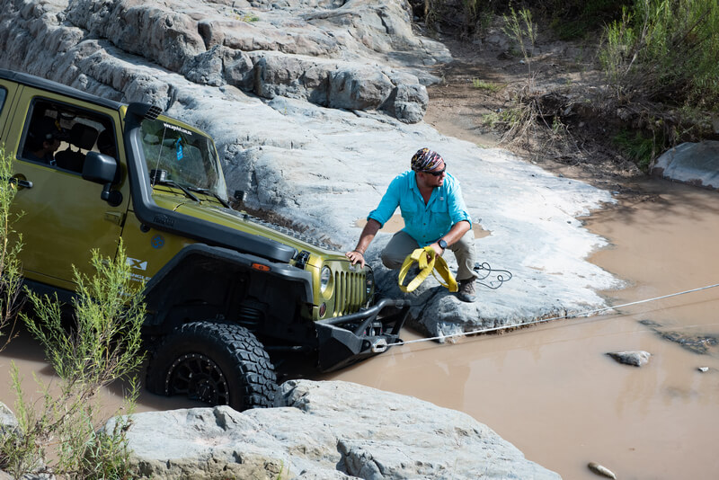 Green Jeep in the mud