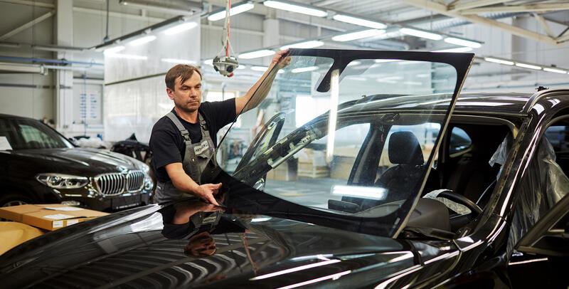 Technician installing a new windshield